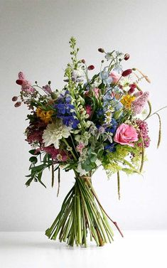 A wild meadow British Flowers brides bouquet. Using lots of different flowers th… - Wedding World Wedding Flower Guide, Winter Wedding Flowers, Bridal Flowers, Flower Bouquet Wedding, Floral Wedding, Wild Flower Wedding, Bouquet Flowers, Wild Flower Bouquets, Wildflower Wedding Bouquets