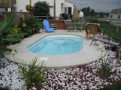 A simple, small fiberglass pool, perfect to just cool off in for that small backyard or small family