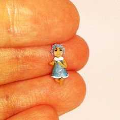 Tiny doll in the blue dress