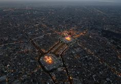 This aerial photo shows Shiite faithful pilgrims gather between, the holy shrine of Imam Hussein, top, and the holy shrine of Imam Abbas, bottom, for Arbaeen in the Shiite holy city of Karbala, 50 miles (80 kilometers) south of Baghdad, Iraq, Saturday, Dec. 13, 2014. The holiday marks the end of the forty day mourning period after the anniversary of the 7th century martyrdom of Imam Hussein, the Prophet Muhammad's grandson. (AP Photo/Hadi Mizban)