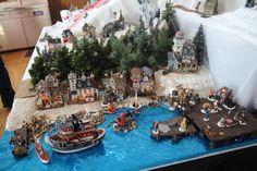 Creating a Christmas village harbor.