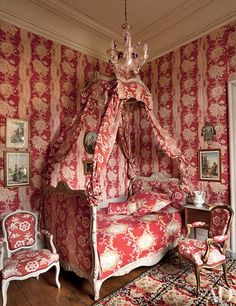 """In a room that Joy de Rohan-Chabot refer to as """"the Polish bedroom"""" in her château, Pierre Frey fabrics dress the Louis XV chairs and the lit à la polonaise."""