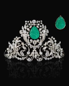 An emerald and diamond tiara, 19th century. Composed of foliate, scroll and swag motifs set with cushion shaped, circular cut, oval and rose diamonds, claw set with a carved emerald depicting the Madonna and Child to the front and the Annunciation to the reverse, inner circumference approximately 350mm, emerald possibly later set.