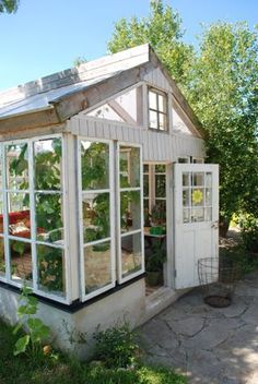this is kinda what i want but attached to my dream kitchen. so then i can just walk into my green house and grab fresh vegatables or herbs. also i want herbs drying randomly inside of it. anhow i love the windows Window Greenhouse, Backyard Greenhouse, Greenhouse Plans, Dream Garden, Home And Garden, Outdoor Spaces, Outdoor Living, Potting Sheds, Lovely Shop