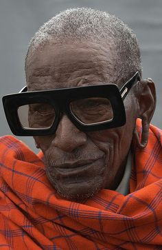 6d1eb895de Kenyan artisan posing for Karen Walker Eyewear Visible Campaign Advanced  Style
