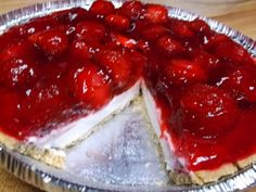 This is a really easy, yet very delicious pie. It's sure to impress your family and your guests. It has a sweet and tart strawberry layer on top of a smooth, lightly sweetened cream cheese layer, with a hint of lemon, in a crunchy graham cracker crust. So pretty and so yummy! (NOTE: Use only frozen berries for best results.)
