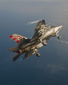 F-35C With External Loads  US Navy test pilot Maj. Justin Carlson is at the controls of F-35C CF-5 during an external stores and strategic refueling mission from NAS Patuxent River, Maryland, on 26 June 2015. The aircraft is loaded with two AIM-9Xs, four GBU-12s, and a gunpod. Photo by Michael D. Jackson