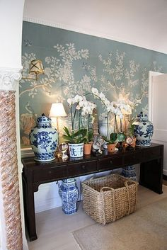 Muraled entryway. Chinoiserie and beautiful orchids