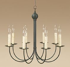 8 Lite J Arm Colonial ChandelierS OVER WALL BOOTH TABLES ON BOTH SIDES  & FIREPLACE SITTING AREA