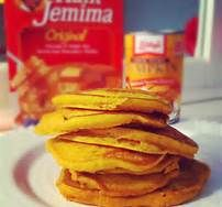 Quick pumpkin pancakes using pancake mix.  Heat griddle to 375 or skillet to medium-low.  Stir together 2 cups of Aunt Jemima Complete pancake mix, 2 T white sugar, 1/3 t ground cinnamon, 1/3 t ground nutmeg.  Add 1 1/4 cups water and stir until large lumps disappear.  Fold in 1 cup of canned pumpkin purée (not pumpkin pie filling).  Pour about 1/4 cup of batter onto griddle.  Flip when top bubbles and bottom is starting to brown.  Made 12 pancakes. (Picture from Google search).