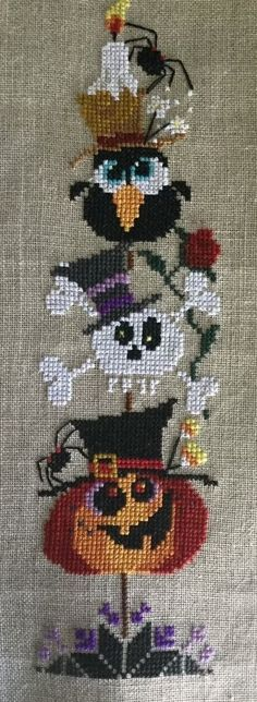 completed cross stitch Halloween Spooky Tree Pumpkin, skeleton flow and spider