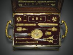 A 'palais royal' sewing necessaire with three-colour gold implements and singing bird, Frères Rochat, Geneva, circa 1820