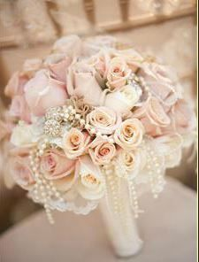 Beautiful wedding bouquet idea. Pink roses of different sizes with some pearls pink bridal bouquet
