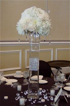 Blinged Lighthouse Vase Centerpiece with White/Ivory Hydrangea, Roses, and Fuji Mums accented with Hanging Crystals