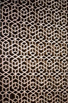 Latticework from the Maharajah's Palace, in Jaipur, India, showing Geometric Pattern using carved masonry or stone relief.