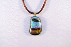 Black and gold dichroic glass pendant with iridescent square from Ivy Tree Designs. $18.20