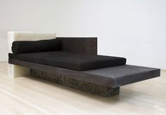 Rick Owens lounge chair. Inspiration on the prehistoric through polish stone and hard and soft materials, wood and stone as well as the geometric forms overlapping