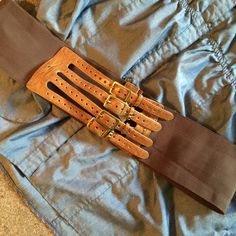 Size 3 plus brown wide belt. Size 3 plus brown wide belt. Adjustable buckles on the front with snaps in the back. Also is made out of stretchy material to help fit your body better. Accessories Belts