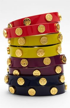 I like to stack 2-3 of these, in a couple different colors. Gives a bit of a polished edge to an otherwise conservative outfit: Tory Burch Logo Double Wrap Bracelet available at #Nordstrom