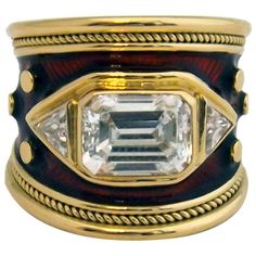 Superb Elizabeth Gage Emerald Cut Diamond Enamel Ring Elizabeth Gage 18 karat yellow gold enamel diamond band, emerald cut 2.68 cts. GIA E VS1 Certified diamond.