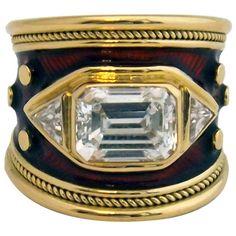 Superb Elizabeth Gage Emerald Cut Diamond Enamel Ring Elizabeth Gage 18 karat yellow gold enamel diamond band, emerald cut 2.68 cts. GIA E VS1 Certified diamond.