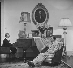 Mrs Elena Lupescu and King Carol II of Romania, at their house at Estoril, Portugal.