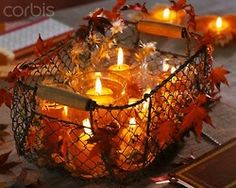 <3<3 wire basket of glowing candles and leaves...so pretty