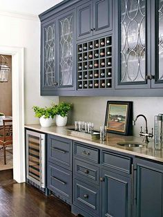 limestone countertop - but I love the cabinetry with somewhat opaque glass and the leading - BH