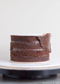 How to ganache a cake by Sweetness & Bite.
