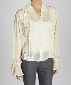 Nothing adds versatility to a wardrobe quite like a new top. And with a button-up like this in a neutral ivory color, the pairing possibilities are effortlessly endless.Measurements (size L): 22'' long from high point of shoulder to hem100% rayonHand wash; hang dryImported