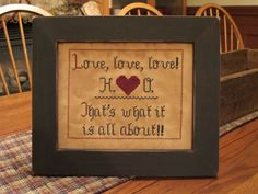 """""""Love, Love, Love"""" sampler.  Designed and stitched by Yesterday Once More Primitives."""