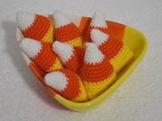 Eight Crocheted Candy Corn and Decorative Ceramic Dish