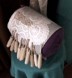 Hungarian bobbin lace pillow and hooded bobbins