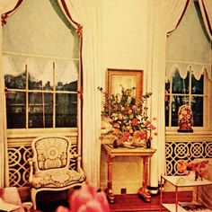 David Hicks-designed London drawing-room of the Marquess & Marchioness of Londonderry. The decorator's way with windows was extremely chic. Here, the white curtains are Venetian drawn & finished at the curved centre-top and at side intervals with red-and-white maltese crosses. Pale cut-out under-blinds complete the fresh effect. Large-scale David Hicks fabric on Louis XV chair. Photograph - Peter Laurie for Vogue, 1964. #davidhickscurtains #londonderrydrawingroom #peterlaurie