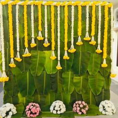 Beautiful leaves n marigold backdrop for mangalasnanam. Desi Wedding Decor, Wedding Stage Design, Wedding Hall Decorations, Marriage Decoration, Backdrop Decorations, Flower Decorations, Mehndi Decor, Mehendi, Housewarming Decorations