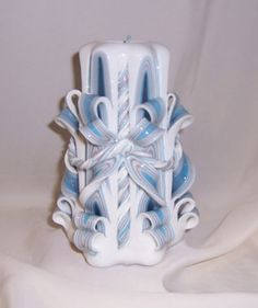 Carved candle#blue and silver bow and twist candle