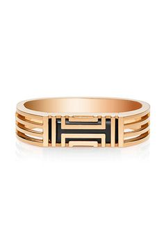 For the fitness buff:  With its stylish fretwork design, the the Tory Burch for Fitbit Metal Hinged Bracelet looks at first glance like a standard bangle, but it's made to house a Fitbit Flex, which tracks steps, distance, calories burned and sleep patterns.