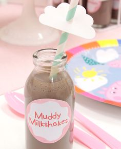 These muddy milkshakes are an easy Peppa Pig party food idea. Simplyrate them with our free printables! fill mini milk bottles with chocolate milkshake and deco