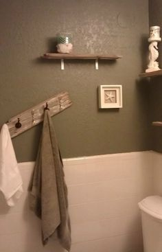 DIY shelves and towel rack using old wood.  plus i like the wall color with the beadboard.  that's what i'm looking for.