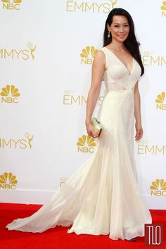 Lucy Liu attens the 2014 Primetime Emmy Awards held at the Nokia Theatre in Los Amgeles, California in a Zac POsen gown paired with a Jimmy ...