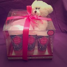 Deluxe teddy bear bath set Gift set of white teddy bear, pink luffa, shower gel, body lotion, body scrub all in rasepberry vanilla sent 2.4 fl oz. brand new never opened still has ribbon on it. Has been sitting in my closet. Other