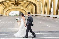 Wedding photo crossing bridge in Sacramento  @myweddingdotcom