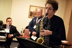 """Twelfth-grader Connor Thomas, 18, performs with an alto saxophone during """"Fantastic 49"""" recognition Feb. 12, ahead of a monthly Board of Education meeting in District 49. Thomas, who's known to master any instrument he focuses on, recently auditioned at the Festival of Winds at Colorado State University in Pueblo. His performance resulted in earning an $11,000 scholarship from the university's music department."""
