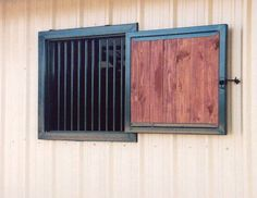 Hinged wood fill window with fixed grill
