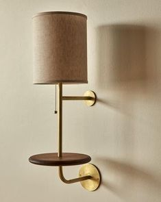 The Gustav Sconce is a sophisticated addition to the Lostine lighting collection. Brushed brass elements are handsomely accented by the dark walnut shelf. The shelf is just wide enough for a phone, a glass or eye wear making it nicely functional but small Wall Sconce Lighting, Home Lighting, Wall Sconces, Wall Lamps, Wall Lights, Lighting Ideas, Element Lighting, Interior Lighting, Kitchen Lighting