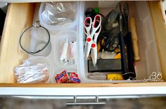 15 Kitchen Organization Ideas  used plastic containers to keep everything neatly organized. As you can see the big container is full of kitchen tools that I use here and there but not everyday