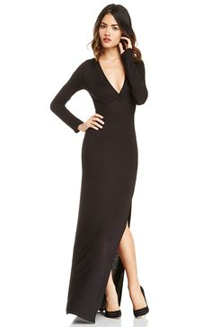 Seductive and sexy define our DAILYLOOK Plunging Maxi. This super stretchy masterpiece clings to your curves like never before. Features a deep V neck, long sleeves, and a sexy front slit hem. The material is slightly sheer so you'll want to add our Seamless Nylon Slip to complete your look.