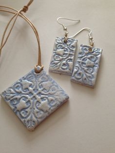 Earrings and necklace made with air dry clay stamped and decorated with acrylics.