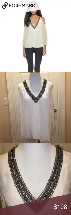 Alice + Olivia NWT Cold Shoulder Top Sz S Alice + Olivia NWT Label Cold Shoulder Top Sz S, color is off white, gunmetal color beaded detail on neckline, retail $398, 100% polyester, Blouse is fully lined except sleeves are not lined, lining is mix of polyester/spandex, never worn, I think I bought this at Saks No Trades Alice + Olivia Tops