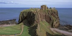 Dunnottar Castle at the edge of the shore, Aberdeenshire. This castle really excites my imagination!